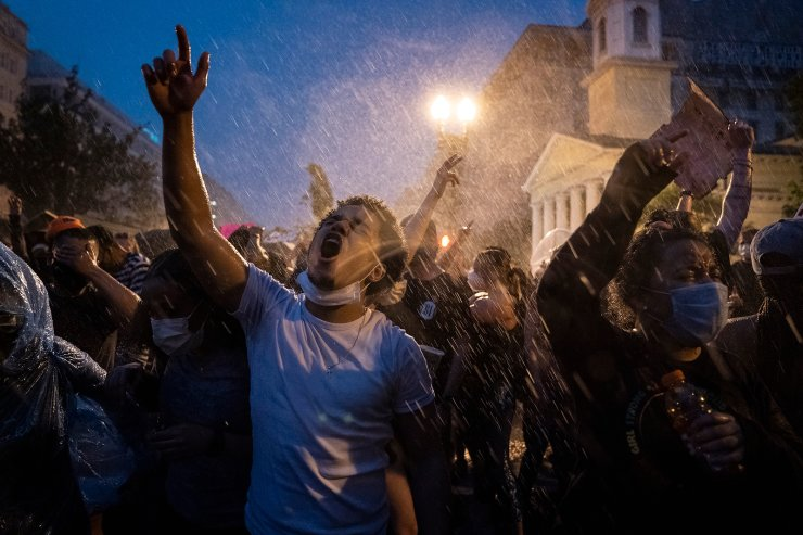 Demonstrators protest, June 4, 2020, near the White House in Washington, D.C., over the death of George Floyd. The image was part of a series of photographs by The Associated Press that won the 2021 Pulitzer Prize for breaking news photography. AP