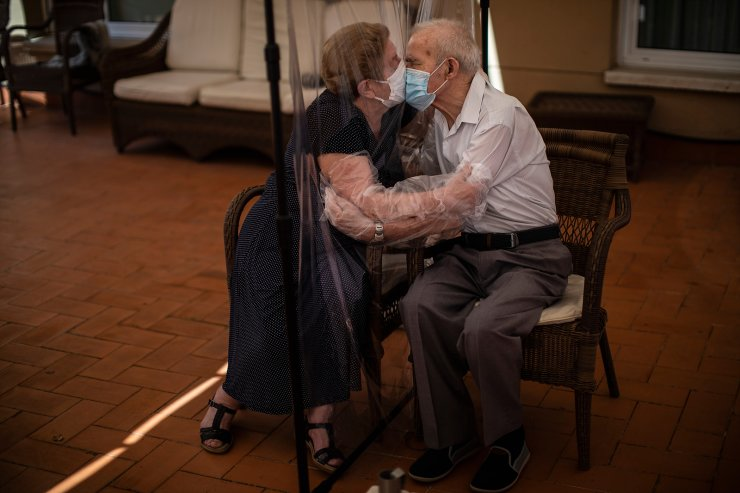 Agustina Cañamero, 81, hugs and kisses her husband Pascual Pérez, 84, through a plastic film screen to avoid contracting the coronavirus at a nursing home in Barcelona, Spain, June 22, 2020. Even when it comes wrapped in plastic, a hug can convey tenderness and relief, love and devotion. The fear that gripped Agustina Cañamero during the 102 days she and her 84-year-old husband spent physically separated during Spain's coronavirus outbreak dissolved the moment the couple embraced through a screen of plastic film. The image was part of a series by Associated Press photographer Emilio Morenatti that won the 2021 Pulitzer Prize for feature photography. AP