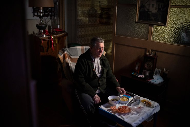 Álvaro Puig Moreno watches television while eating a his Christmas Eve dinner at his home in Barcelona, Spain, Dec. 24, 2020. 'The solitude gets to me these days, I often feel depressed,' Puig said. 'These holidays, instead of making me happy, make me sad. I hate them. Most of family has died, I am one of the last ones left. I will spend Christmas at home alone because I don't have anyone to spend them with.' The image was part of a series by Associated Press photographer Emilio Morenatti that won the 2021 Pulitzer Prize for feature photography. AP