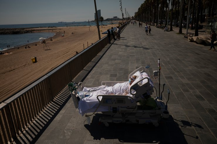 Francisco España, 60, looks at the Mediterranean sea from a promenade next to the 'Hospital del Mar' in Barcelona, Spain, Sept. 4, 2020. Francisco spent 52 days in the ICU of the hospital due to an infection of Coronavirus and he has being allowed by his doctors on this day to spend almost ten minutes at the seaside as part of a therapy to recover from the ICU. The image was part of a series by Associated Press photographer Emilio Morenatti that won the 2021 Pulitzer Prize for feature photography. AP