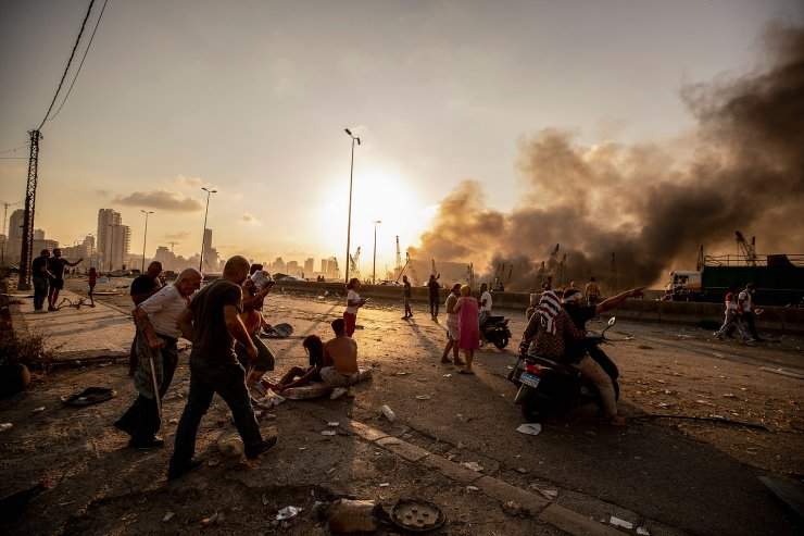 Wounded people are evacuated as smoke rises from a massive explosion in Beirut, Lebanon, Tuesday, Aug. 4, 2020. The image was part of a series of photographs by The Associated Press that was a finalist for the 2021 Pulitzer Prize for breaking news photography. AP