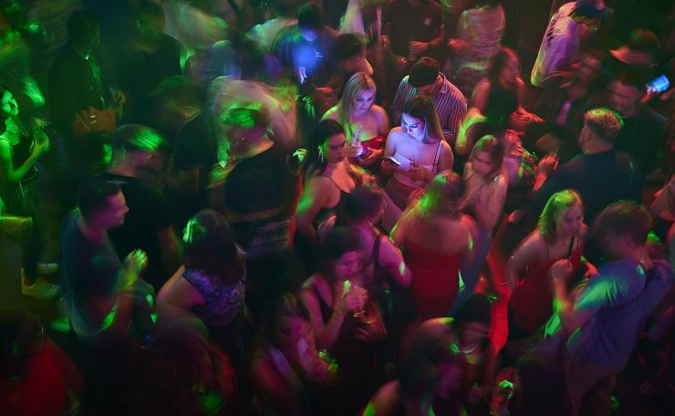 People celebrate at the MAD (Moulin a Danse) night club on the first evening after COVID-19 measures were eased enabling the reopening of discotheques at full capacity and without mask upon presentation of COVID certificates in Lausanne, Switzerland, early Saturday, June 26, 2021. AP
