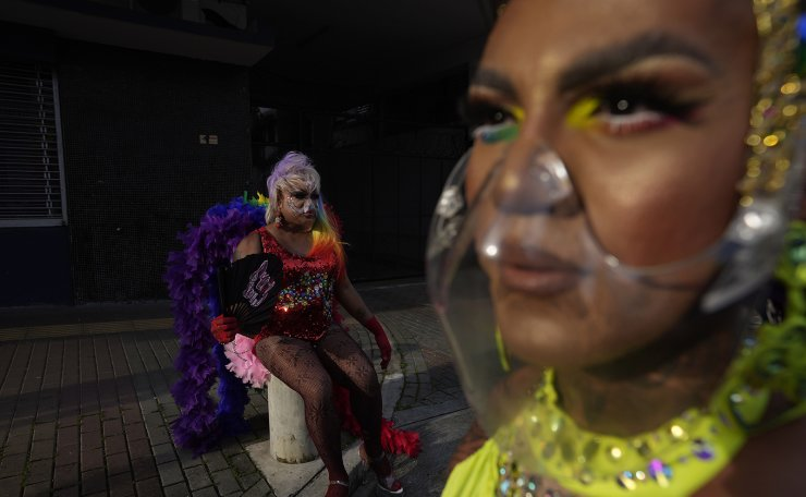 Drag queens, wearing protective face masks, take a break during the annual Gay Pride parade in Panama City, Saturday, June 26, 2021. AP
