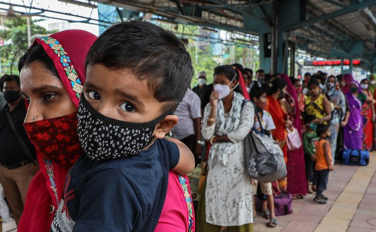 Indian passengers wearing face masks stand in queue to get tested for COVID-19 detection test after arriving from other states of India to Mumbai, at Dadar railway station in Mumbai, India, 29 June 2021. According to a sero-survey conducted by Brihanmumbai Municipal Corporation (BMC) during 01 April 2021, to 15 June 2021 on 2000 kids from Mumbai, revealed that over 51 per cent of children in Mumbai, below 18 years. EPA