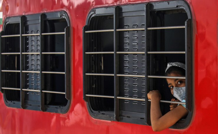 An Indian girl wearing face mask gestures as he arrives from other states of India to Mumbai, at Dadar railway station in Mumbai, India, 29 June 2021. According to a sero-survey conducted by Brihanmumbai Municipal Corporation (BMC) during 01 April 2021, to 15 June 2021 on 2000 kids from Mumbai, revealed that over 51 per cent of children in Mumbai, below 18 years have developed antibodies for COVID-19. EPA