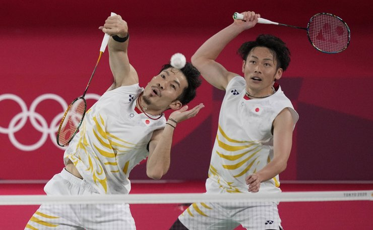 Japan's Takeshi Kamura and Keigo Sonoda play against China's Li Jun Hui and Liu Yu Chen during their men's doubles group play stage badminton match at the 2020 Summer Olympics, Tuesday, July 27, 2021, in Tokyo, Japan. AP