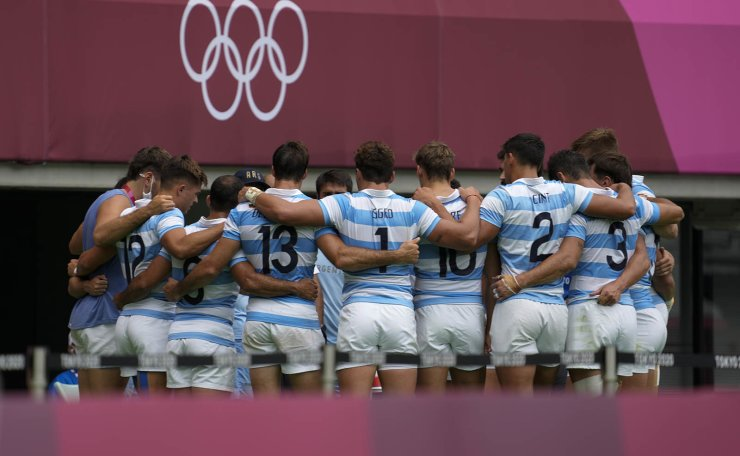 Argentina's team huddles up after winning their men's rugby sevens match against South Korea at the 2020 Summer Olympics, Tuesday, July 27, 2021 in Tokyo, Japan. AP