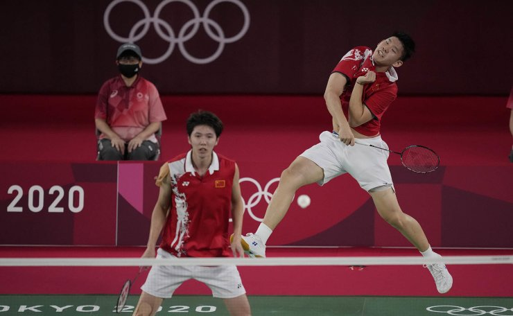 China's Li Jun Hui and Liu Yu Chen play against Japan's Takeshi Kamura and Keigo Sonoda during their men's doubles group play stage badminton match at the 2020 Summer Olympics, Tuesday, July 27, 2021, in Tokyo, Japan. AP