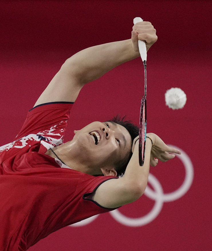 China's Liu Yu Chen plays with Li Jun Hui and against Japan's Takeshi Kamura and Keigo Sonoda during their men's doubles group play stage badminton match at the 2020 Summer Olympics, Tuesday, July 27, 2021, in Tokyo, Japan. AP