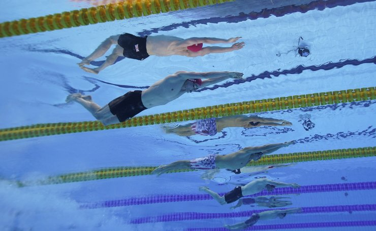 21Britain's Duncan Scott, top, swims to win the silver medal in the 200-meter freestyle final at the 2020 Summer Olympics, Tuesday, July 27, 2021, in Tokyo. AP