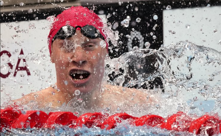 Tom Dean of Britain celebrates after winning the final of the men's 200-meter freestyle at the 2020 Summer Olympics, Tuesday, July 27, 2021, in Tokyo, Japan. AP