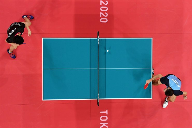 Tokyo 2020 Olympics - Table Tennis - Men's Singles - Round 3 - Tokyo Metropolitan Gymnasium - Tokyo, Japan - July 27, 2021. Panagiotis Gionis of Greece in action against Jeoung Young-Sik of South Korea. REUTERS