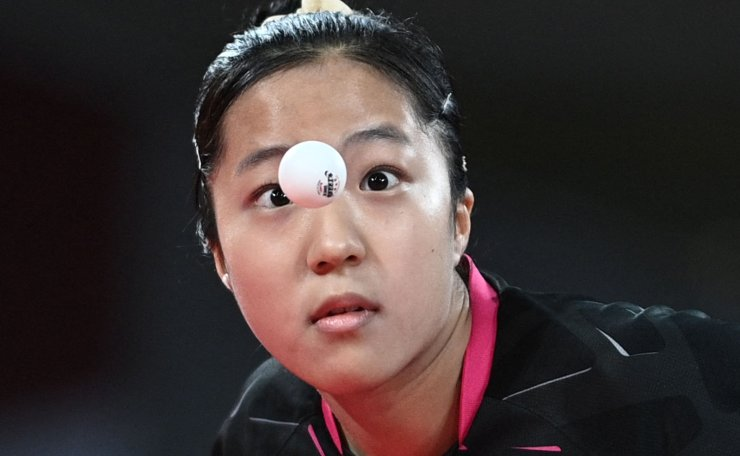 South Korea's Shin Yu-bin competes against Hong Kong's Doo Hoi-kem during her women's singles round 3 table tennis match at the Tokyo Metropolitan Gymnasium during the Tokyo 2020 Olympic Games in Tokyo on July 27, 2021. AFP