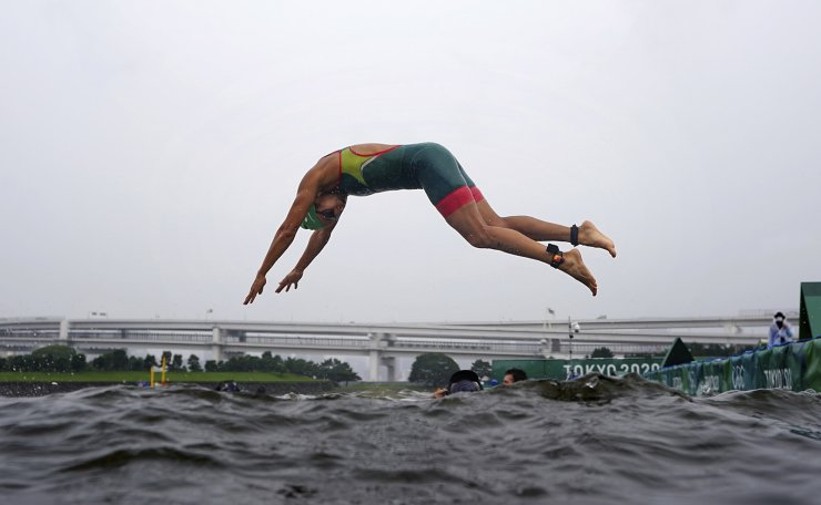 Cecilia Perez, of Mexico, dives into the water for the start of the women's individual triathlon at the 2020 Summer Olympics, Tuesday, July 27, 2021, in Tokyo. AP