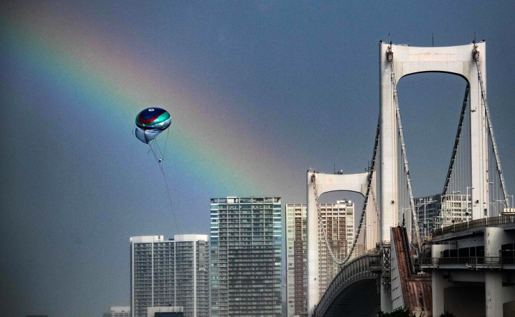 A rainbow is seen during the Tokyo 2020 Olympic Games at the Odaiba Marine Park in Tokyo on July 27, 2021, as Tropical Storm Nepartak approached Japan's northeast coast. AFP