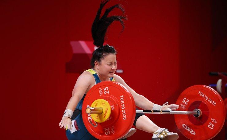 Tokyo 2020 Olympics - Weightlifting - Women's 59kg - Group B - Tokyo International Forum, Tokyo, Japan - July 27, 2021. Erika Yamasaki of Australia reacts after failing a lift. REUERS