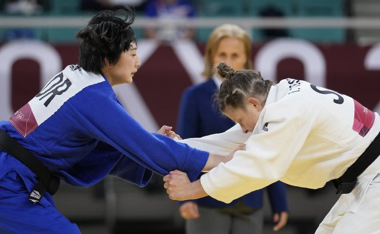 Tina Trstenjak of Slovenia, right, and Han Heeju of South Korea compete during the women -63kg elimination round of the judo match at the 2020 Summer Olympics in Tokyo, Japan, Tuesday, July 27, 2021. AP