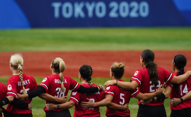 Members of team Canada stand ahead of a softball game against Mexico at the 2020 Summer Olympics, Tuesday, July 27, 2021, in Yokohama, Japan. AP