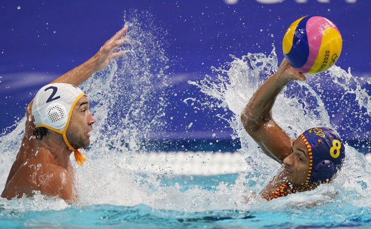 Montenegro's Drasko Brguljan (2) defends against Spain's Francisco Fernandez Miranda (8) during a preliminary round men's water polo match at the 2020 Summer Olympics, Tuesday, July 27, 2021, in Tokyo, Japan. AP