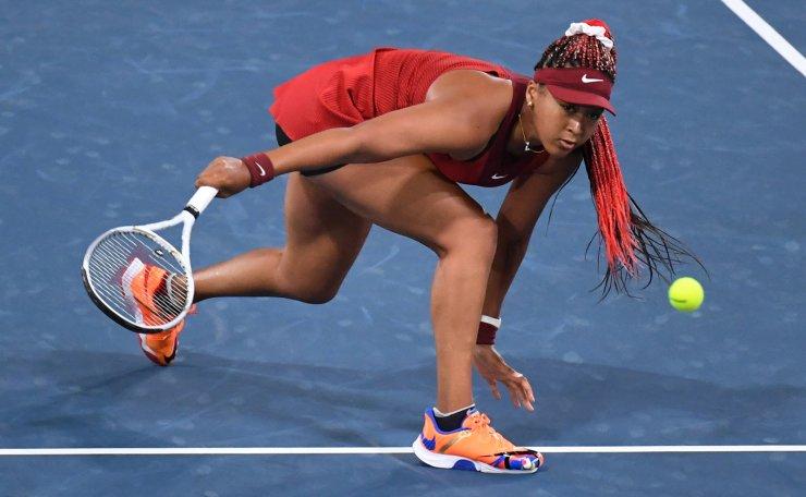 Tokyo 2020 Olympics - Tennis - Women's Singles - Round 3 - Ariake Tennis Park - Tokyo, Japan - July 27, 2021. Naomi Osaka of Japan in action during her third round match against Marketa Vondrousova of Czech Republic. REUTERS