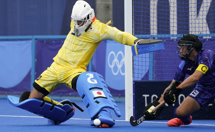 Japan goalkeeper Takashi Yoshikawa (30) makes a save on a penalty corner during a men's field hockey match against New Zealand at the 2020 Summer Olympics, Tuesday, July 27, 2021, in Tokyo, Japan. AP