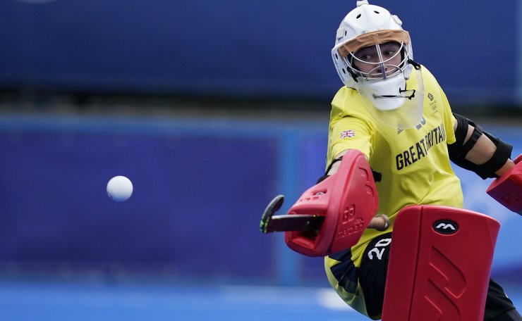 Great Britain goalkeeper Oliver Payne (20) watches the ball pass him against Germany during a Men's field hockey match at the 2020 Summer Olympics, Tuesday, July 27, 2021, in Tokyo, Japan. AP