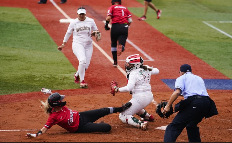 Canada's Victoria Hayward, left, is tag out by Mexico catcher Sashel Palacios during a softball game at the 2020 Summer Olympics, Tuesday, July 27, 2021, in Yokohama, Japan. AP
