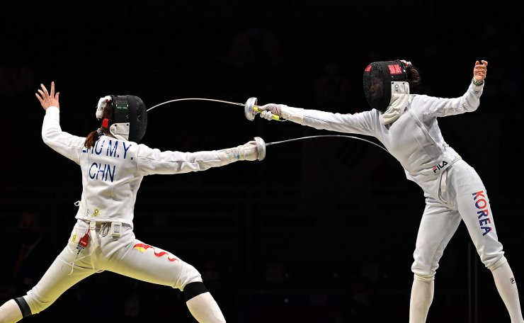 South Korea's Choi Injeong (R) compete against China's Zhu Mingye in the women?s team epee semi-final bout during the Tokyo 2020 Olympic Games at the Makuhari Messe Hall in Chiba City, Chiba Prefecture, Japan, on July 27, 2021. AFP