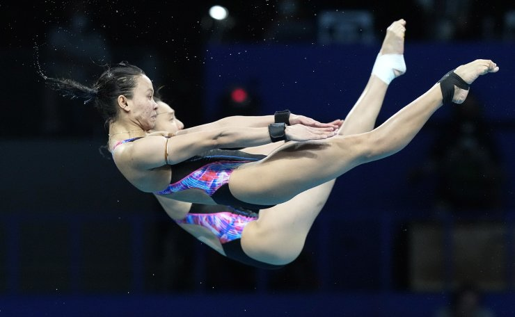 Mun Yee Leong and Pandelela Pamg of Malaysia compete during the women's synchronized 10m platform diving final at the Tokyo Aquatics Centre at the 2020 Summer Olympics, Tuesday, July 27, 2021, in Tokyo, Japan. AP