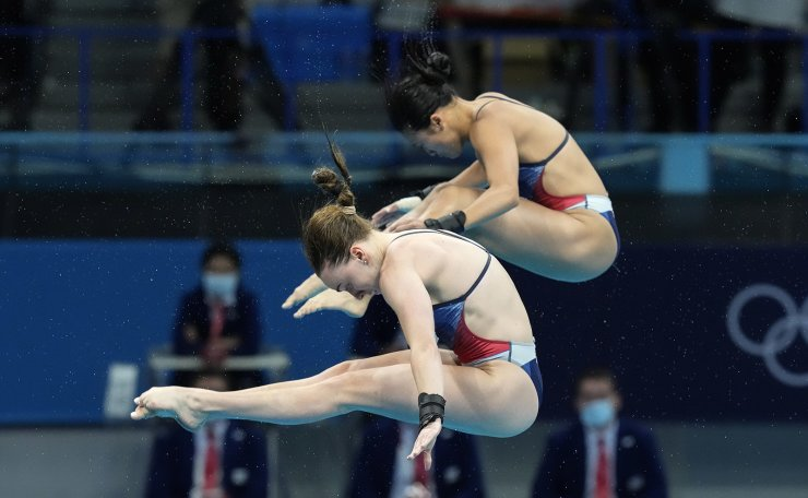 Eden Cheng and Lois Toulson of Britain compete during the women's synchronized 10m platform diving final at the Tokyo Aquatics Centre at the 2020 Summer Olympics, Tuesday, July 27, 2021, in Tokyo, Japan. AP