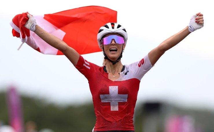Tokyo 2020 Olympics - Mountain Bike - Women's Cross Country - Final - Izu MTB Course - Shizuoka, Japan - July 27, 2021.  Jolanda Neff of Switzerland celebrates winning gold. REUTERS