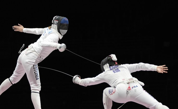 Julia Beljajeva of Estonia, left, and Kang Young Mi of South Korea compete in the women's individual Epee team final competition at the 2020 Summer Olympics, Tuesday, July 27, 2021, in Chiba, Japan. AP