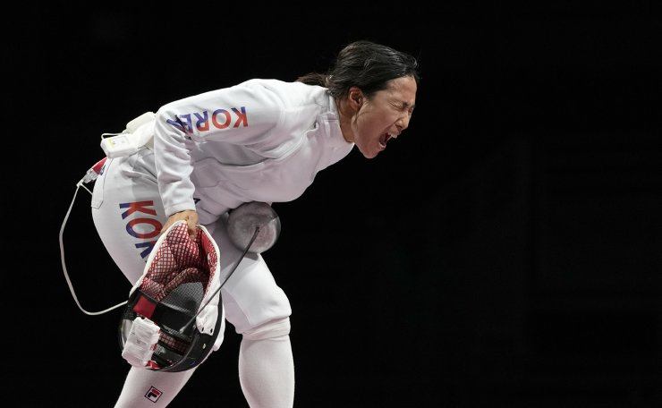Kang Young Mi of South Korea celebrates winning a point against Julia Beljajeva of Estonia in the women's individual Epee team final competition at the 2020 Summer Olympics, Tuesday, July 27, 2021, in Chiba, Japan. AP