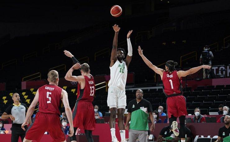 Nigeria's Chimezie Metu (10) shoots between Germany's Moritz Wagner (13) and Joshiko Saibou (1) during men's basketball preliminary round game at the 2020 Summer Olympics, Wednesday, July 28, 2021, in Saitama, Japan. AP