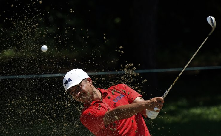 United States' Xander Shauffele plays a shot from a bunker during a practice round of the men's golf event at the 2020 Summer Olympics, Tuesday, July 27, 2021, at the Kasumigaseki Country Club in Kawagoe, Japan. AP