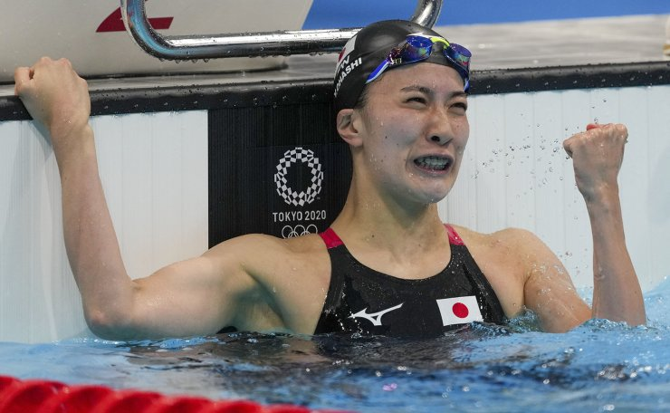 Yui Ohashi, of Japan, reacts after winning the women's 200-meter individual medley final at the 2020 Summer Olympics, Wednesday, July 28, 2021, in Tokyo, Japan. AP