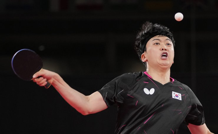 South Korea's Jeoung Young-sik competes during the table tennis men's singles quarterfinal match against China's Fan Zhendong at the 2020 Summer Olympics, Wednesday, July 28, 2021, in Tokyo. AP