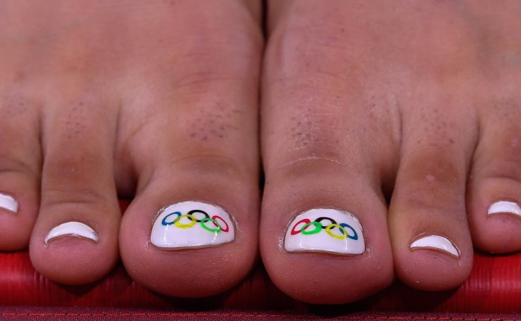 The Olympic rings are seen painted on the toenails of Nigara Shaheen of the Refugee Olympic Team before the preliminary round of women's judo -70kg category of the Tokyo 2020 Olympic Games in Nippon Budokan Arena in Tokyo, Japan, 28 July 2021. EPA