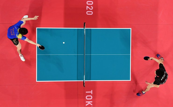 Tokyo 2020 Olympics - Table Tennis - Men's Singles - Quarterfinal - Tokyo Metropolitan Gymnasium - Tokyo, Japan - July 28, 2021. Fan Zhendong of China in action against Jeoung Young-Sik of South Korea Pool via REUTERS