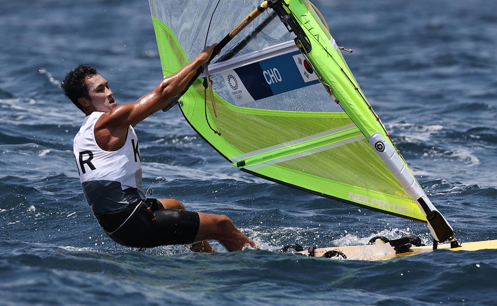 Tokyo 2020 Olympics - Sailing - Men's RS:X - Opening Series - Enoshima Yacht Harbour - Tokyo, Japan - July 28, 2021. Cho Won-woo of South Korea prepares before competing. REUTERS