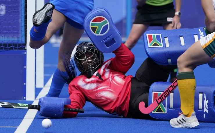South Africa goalkeeper Phumelela Luphumlo Mbande (1) stops a shot by Netherlands during a women's field hockey match at the 2020 Summer Olympics, Wednesday, July 28, 2021, in Tokyo, Japan. AP