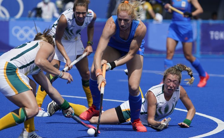 Netherlands' Margot van Geffen (23) drives around South Africa's Celia Beatrice Seerane, who has fallen on the pitch, during a women's field hockey match at the 2020 Summer Olympics, Wednesday, July 28, 2021, in Tokyo, Japan. AP