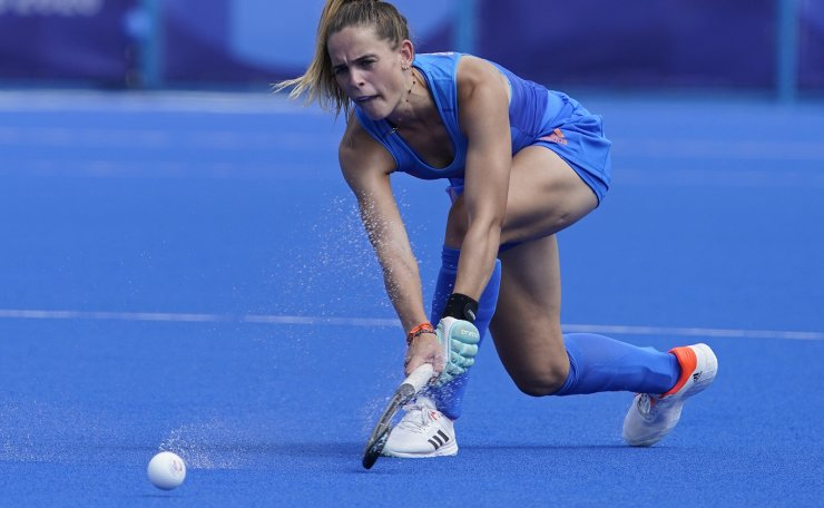 Netherlands' Pien Sanders (18) passes aginast South Africa during a women's field hockey match at the 2020 Summer Olympics, Wednesday, July 28, 2021, in Tokyo, Japan. AP
