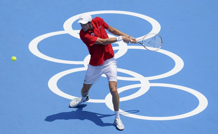 Daniil Medvedev, of the Russian Olympic Committee, returns to Fabio Fognini, of Italy, during the third round of the men's tennis competition at the 2020 Summer Olympics, Wednesday, July 28, 2021, in Tokyo, Japan. AP