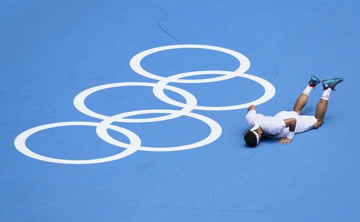 Fabio Fognini, of Italy, reacts after losing a point to Daniil Medvedev, of the Russian Olympic Committee, during the third round of the men's tennis competition at the 2020 Summer Olympics, Wednesday, July 28, 2021, in Tokyo, Japan. AP
