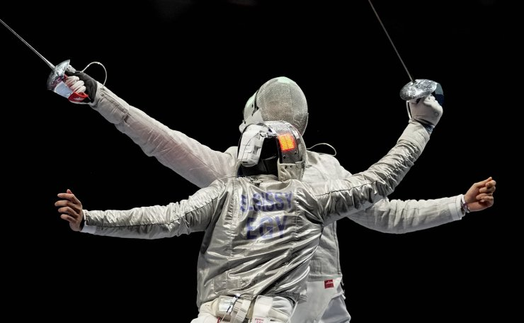 Ziad Elsissy of Egypt, left, and Oh Sanguk of South Korea compete in the men's Sabre team quarterfinal at the 2020 Summer Olympics, Wednesday, July 28, 2021, in Chiba, Japan. AP