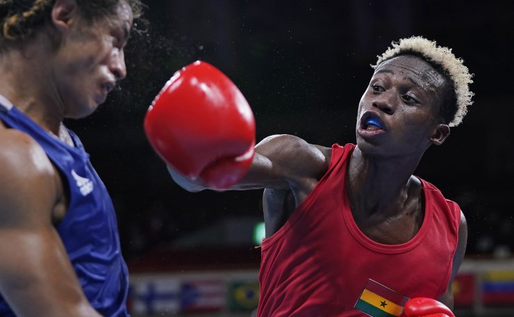 Ghana's Samuel Takyi punches Ecuador's Jean Carlos Caicedo Pachito during the men's featherweight 57-kg preliminaries boxing match at the 2020 Summer Olympics, Wednesday, July 28, 2021, in Tokyo, Japan. AP