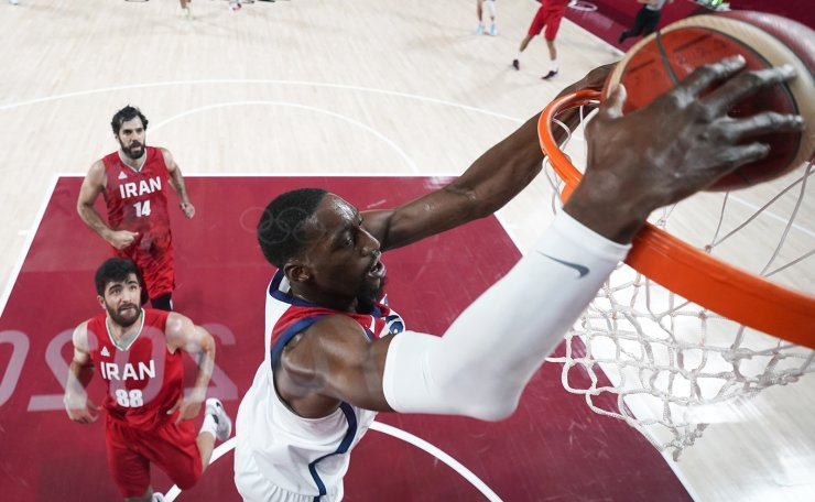 United States' Bam Adebayo dunks the ball ahead of Iran's Behnam Yakhchalidehkordi (88) during a men's basketball preliminary round game at the 2020 Summer Olympics, Wednesday, July 28, 2021, in Saitama, Japan. AP