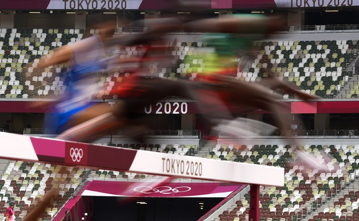 Runners compete in a heat of the men's 3,000-meter steeplechase at the 2020 Summer Olympics, Friday, July 30, 2021, in Tokyo. AP