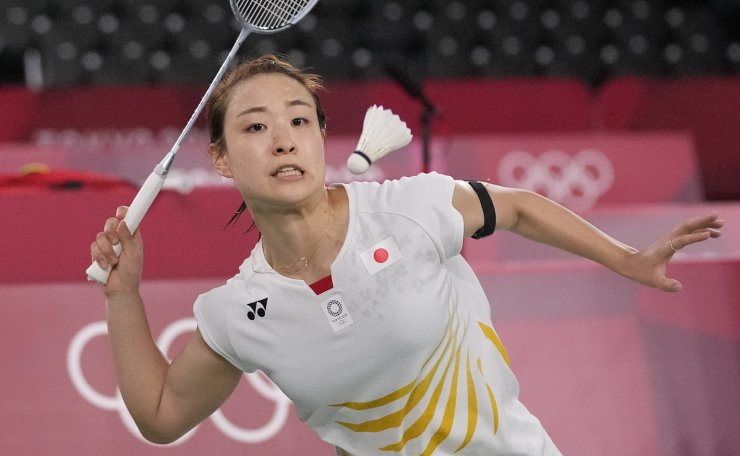 Japan's Nozomi Okuhara plays against China's He Bing Jiao during their women's singles badminton quarterfinal match at the 2020 Summer Olympics, Friday, July 30, 2021, in Tokyo, Japan. AP